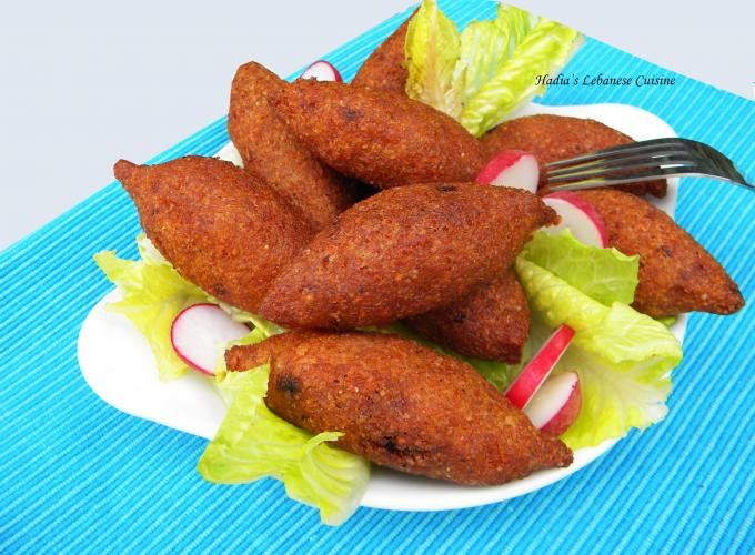 Fried Potato Kibbeh Balls...The outer shell  is made with mashed potatoes and kneaded with fine bulgur.  The dough is stuffed with a filling of minced beef or lamb and walnuts, seasoned with sumac, allspice, cinnamon powder and chili flakes
