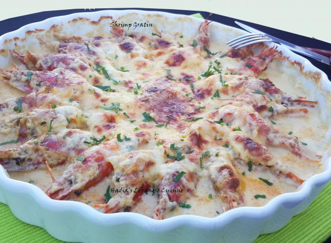 Shrimp Gratin.  A warm comforting and a full of flavor shrimp gratin, shrimp with a creamy white sauce that is seasoned with brine capers and Dijon mustard and covered with Swiss cheese.