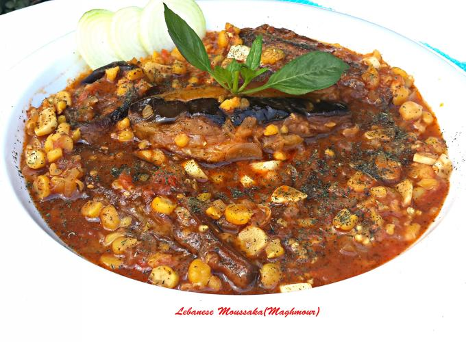 ... eggplant stew with chickpeas, garlic , onions, tomatoes and dried mint